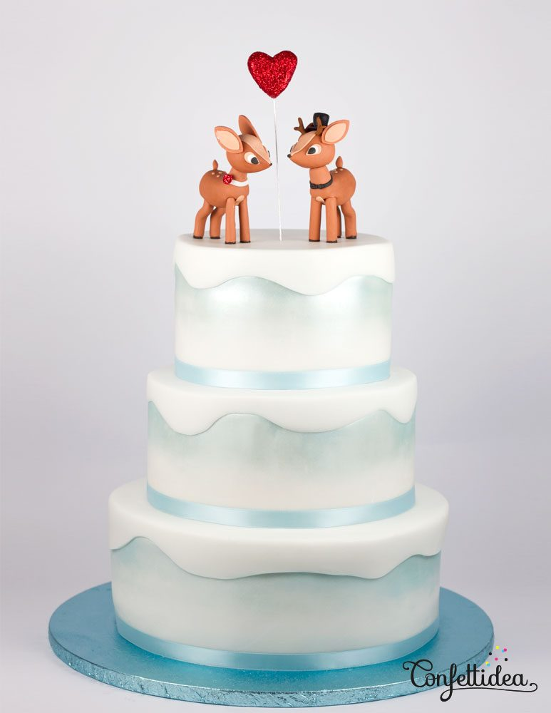 winter wedding cake with reindeer figurines